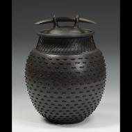 Larry Richmond: Stoneware coverd jar leather laced